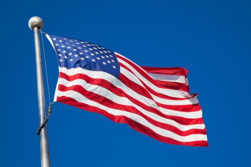 Fourth of July「American flag waving in breeze on pole」:スマホ壁紙(13)