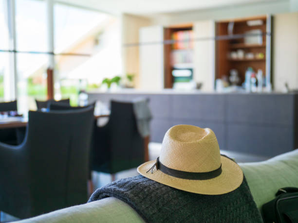 Panama hat on couch in a modern villa:スマホ壁紙(壁紙.com)