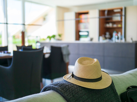 Focus On Foreground「Panama hat on couch in a modern villa」:スマホ壁紙(16)