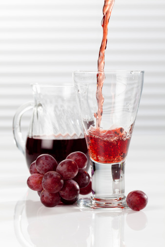 Grape Juice「Carafe and glass with pouring red grape juice, close up」:スマホ壁紙(0)