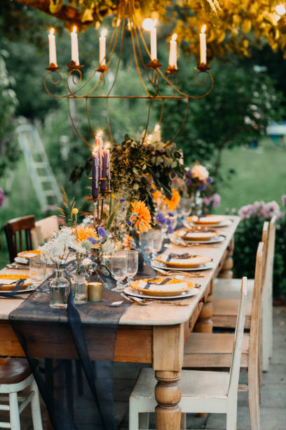 Festive laid table with candles outdoors:スマホ壁紙(壁紙.com)