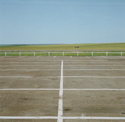 Empty Road「Empty car park, road and fields in distance」:スマホ壁紙(17)