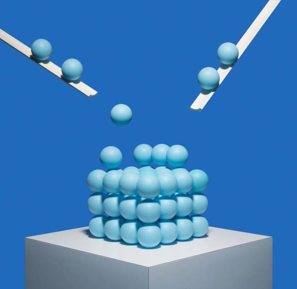 Blue balls being deposited onto square pile:スマホ壁紙(壁紙.com)