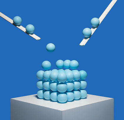 Order「Blue balls being deposited onto square pile」:スマホ壁紙(10)