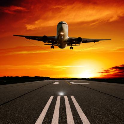 Approaching「XL jet airplane landing at sunset」:スマホ壁紙(9)