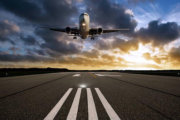 XXL jet airplane landing at sunset:スマホ壁紙(壁紙.com)