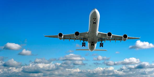 Approaching「jet airplane landing in bright sky」:スマホ壁紙(14)