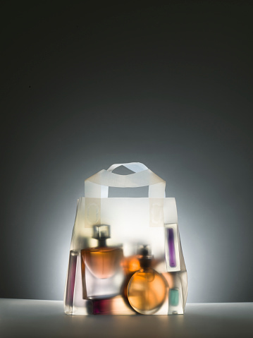 Glowing「Clear shopping bag with perfume bottles inside」:スマホ壁紙(0)