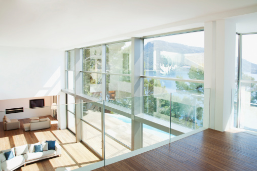 Villa「Banister overlooking modern living space」:スマホ壁紙(2)