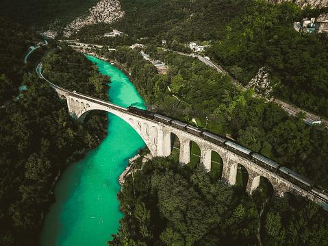 Slovenia「Drone Shot of Historical Old Train Passing Solkan Stone Bridge over Soča River」:スマホ壁紙(18)