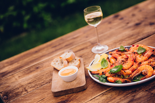 Prawn - Seafood「Wooden table outdoors with barbecued prawns and white wine」:スマホ壁紙(18)