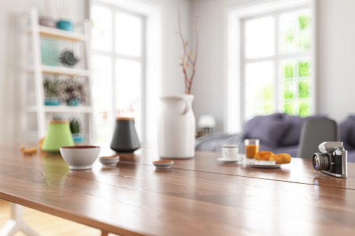 Horizontal「Wooden Table Top with Blur of Modern Living Room Interior」:スマホ壁紙(3)