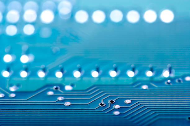 Close-up background image of a blue circuit board:スマホ壁紙(壁紙.com)