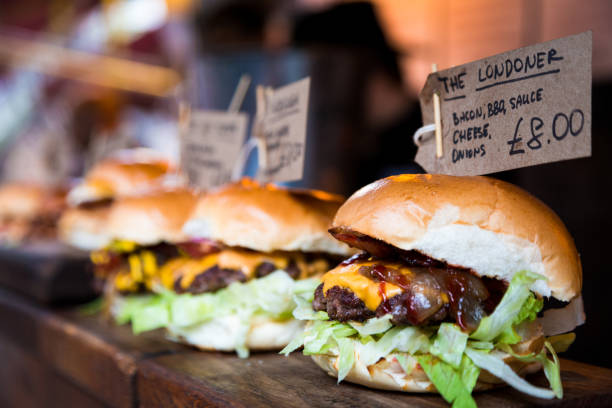 Freshly flame grilled burgers displayed in a row at Borough Market, London:スマホ壁紙(壁紙.com)