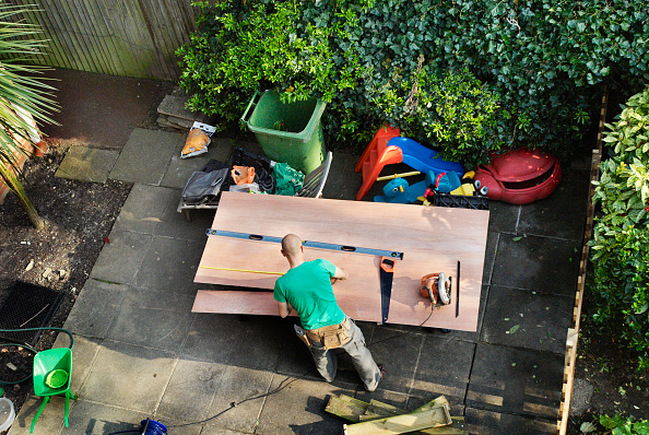 Front or Back Yard「Arial view looking down on a carpenter measuring and cutting wood, North London, UK」:写真・画像(11)[壁紙.com]