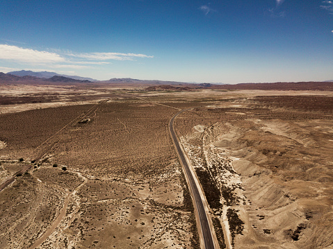 Landscape Arch「Arial view of empty road in the desert」:スマホ壁紙(13)