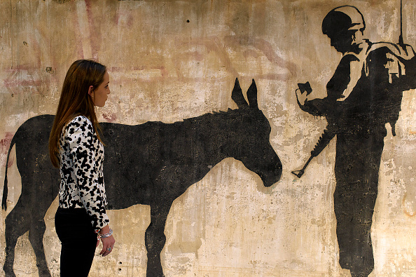 Arts Culture and Entertainment「Banksy West Bank Artwork Goes On Display Before Beverly Hills Auction」:写真・画像(5)[壁紙.com]