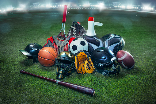 Sports Equipment「Sports balls on the field with yard line. Soccer ball, American football and Baseball in yellow glove on green grass. Outdoors」:スマホ壁紙(2)
