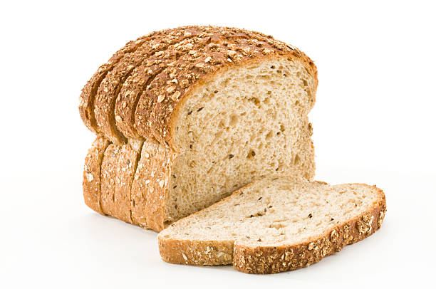Detailed close-up of sliced grain bread on white background:スマホ壁紙(壁紙.com)