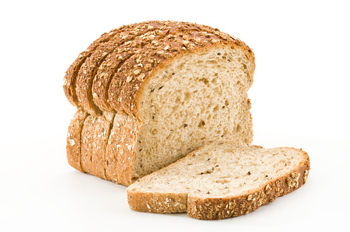 Sliced Bread「Detailed close-up of sliced grain bread on white background」:スマホ壁紙(3)