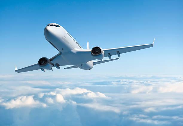 Passenger jet airplane flying above clouds:スマホ壁紙(壁紙.com)