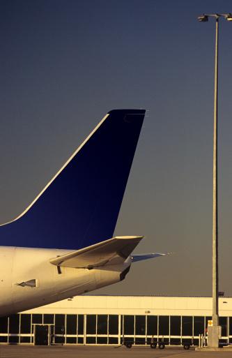 Passenger「Passenger jet tailplane against airport terminal」:スマホ壁紙(5)