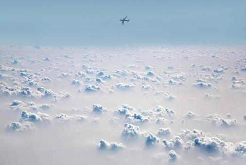 Cumulus Cloud「Passenger jet flying above cloud field.」:スマホ壁紙(7)