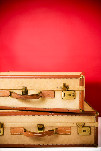 Suitcase「Two antique suitcases stacked  against red background」:スマホ壁紙(15)