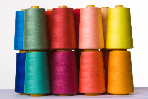 Cotton Mill「A pile of multicolored spools of sewing thread」:スマホ壁紙(3)