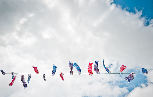 こどもの日「Japan, Okinawa, Children's day koi flags against clouds」:スマホ壁紙(16)
