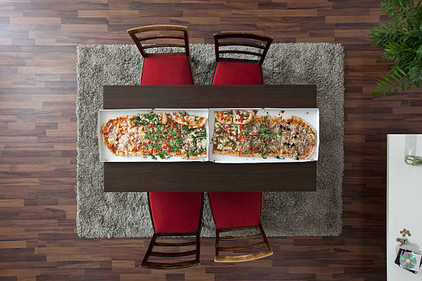 Two large pizzas side by side running the length of a table, overhead view:スマホ壁紙(壁紙.com)