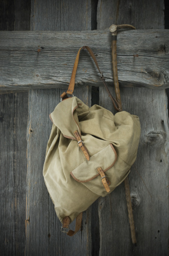 Tradition「Old backpack and walking stick hanging on wooden wall」:スマホ壁紙(13)