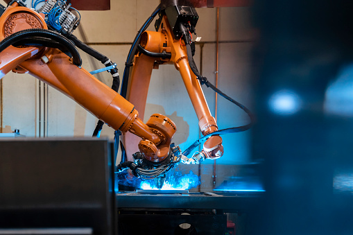 Welding「Orange color robotic arms manufacturing in industrial factory」:スマホ壁紙(10)