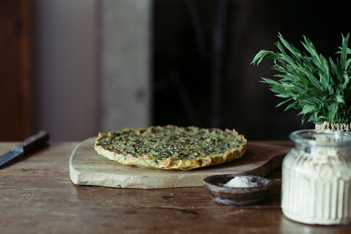 Tarragon「Homemade chickpea and herb cake on wooden table」:スマホ壁紙(1)