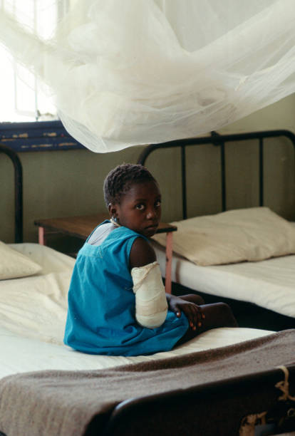 Patient at Rural Hospital, Gambia:ニュース(壁紙.com)