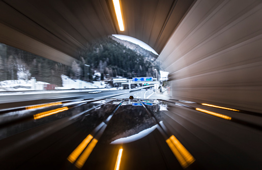 St Anton am Arlberg「Automotive on board a car long exposure rigging shot of the roof of a black german van, streaking reflections in the surface of the car in foreground, antenna and front end of the top in mid ground, the background is blurred motion.」:スマホ壁紙(8)
