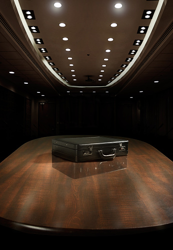 Board Room「Black brief case on top of corporate meeting table」:スマホ壁紙(1)