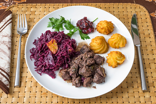 Venison「Wild boar goulash with red cabbage, croquette, lingonberry and parsley on plate」:スマホ壁紙(19)