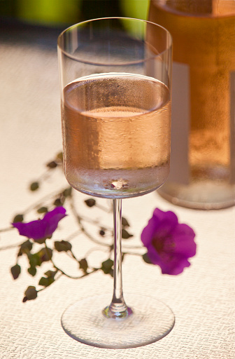 Rose - Flower「Rose wine in a glass with bottle and flower on a table lighted from below」:スマホ壁紙(19)