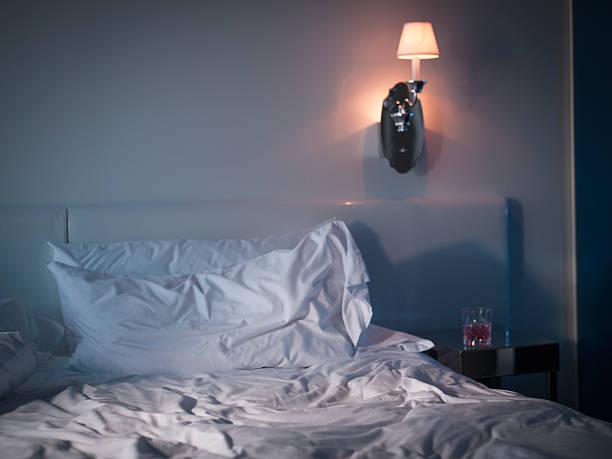 Messy sheets on bed in bedroom:スマホ壁紙(壁紙.com)