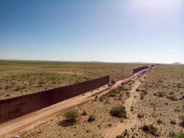 An Aerial View Of The International Border Wall With Portions Still Under Construction:スマホ壁紙(壁紙.com)