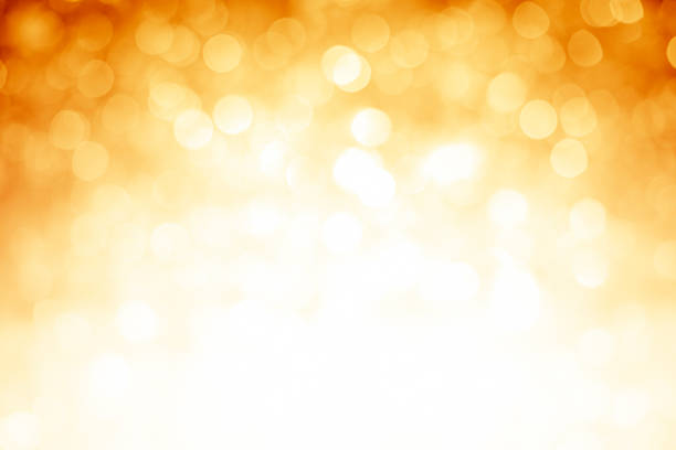 Blurred gold sparkles background with darker top corners:スマホ壁紙(壁紙.com)