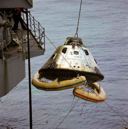 Landing - Touching Down「March 13, 1969 - The Apollo 9 Command Module (CM), with flotation collar still attached, is hoisted aboard the prime recovery ship, USS Guadalcanal, during recovery operations. 」:スマホ壁紙(11)