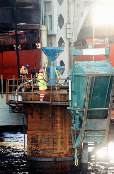 Pouring「Concreting on one of the piles from a platform around the top with skip for initial input - view from beneath jack up barge with pile guide for drilling in foreground, Firth of Forth bridge」:写真・画像(6)[壁紙.com]