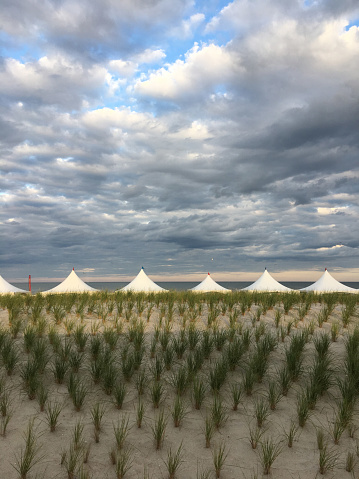 Entertainment Tent「White tents in a row with sunny dramatic sky」:スマホ壁紙(0)