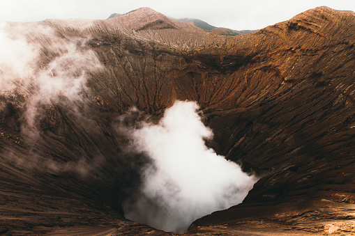 Volcano「Dramatic view of Bromo volcano erupting during sunrise in Indonesia」:スマホ壁紙(8)