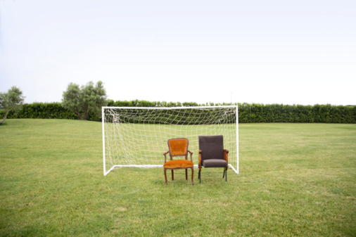 Goal Post「Two chairs on grass in front of small football goal post」:スマホ壁紙(15)