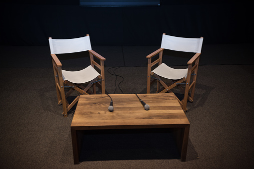 Meeting「Two chairs, microphones and table in an auditorium」:スマホ壁紙(7)