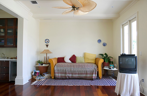 Ceiling Fan「Colorful cushions are arranged on a couch in a living room」:スマホ壁紙(18)
