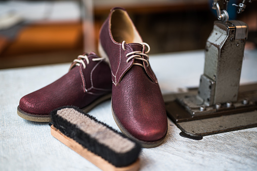 Tradition「Beautiful custom made leather shoes next to sewing machine.」:スマホ壁紙(9)